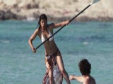 Michelle Rodriguez Paddle Boards In Spain