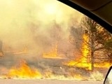 Weather Aids Arizona Fire Battle